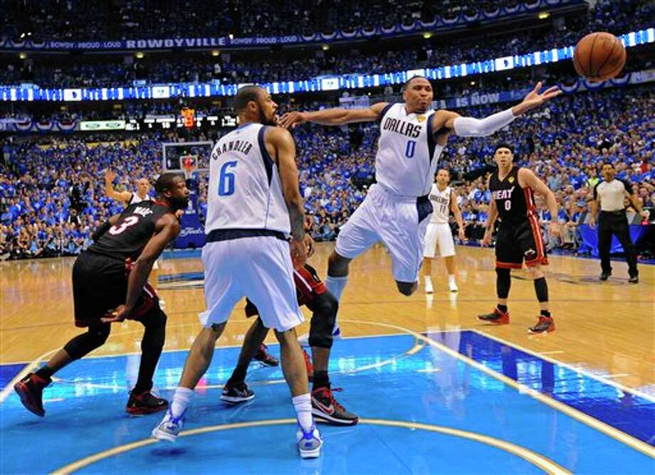 Dallas Mavericks' Shawn Marion (0) goes after a loose ball during the first half of Game 5 of the NBA Finals basketball game against the Miami Heat Thursday, June 9, 2011, in Dallas. (AP Photo/Larry W. Smith; Pool) Photo: Larry W. Smith, Associated Press / EPA Pool