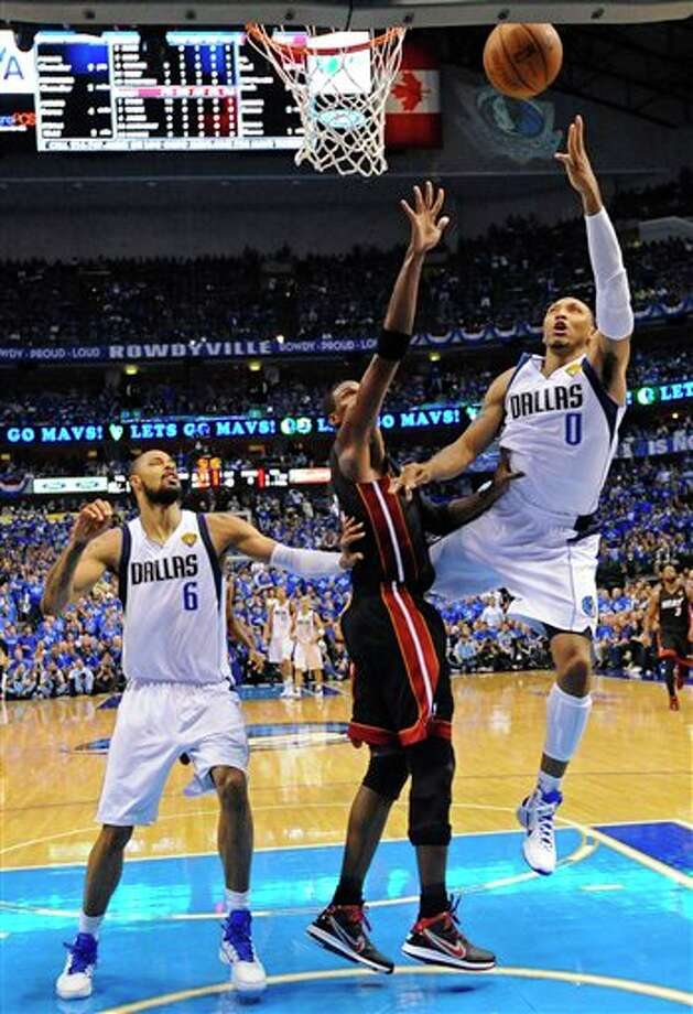 Dallas Mavericks' Shawn Marion (0) shoots past Miami Heat's Chris Bosh during the first half of Game 5 of the NBA Finals basketball game Thursday, June 9, 2011, in Dallas. (AP Photo/Larry W. Smith; Pool) Photo: Larry W. Smith, Associated Press / EPA Pool