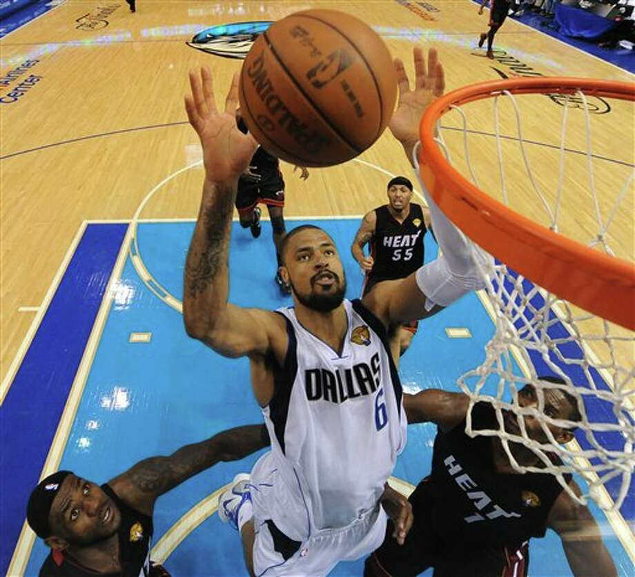 Dallas Mavericks' Tyson Chandler (6) goes after a rebound against Miami Heat's LeBron James, left, and Chris Bosh (1) during the first half of Game 5 of the NBA Finals basketball game Thursday, June 9, 2011, in Dallas. (AP Photo/Mark Ralston; Pool) Photo: Mark Ralston, Associated Press / AP2011