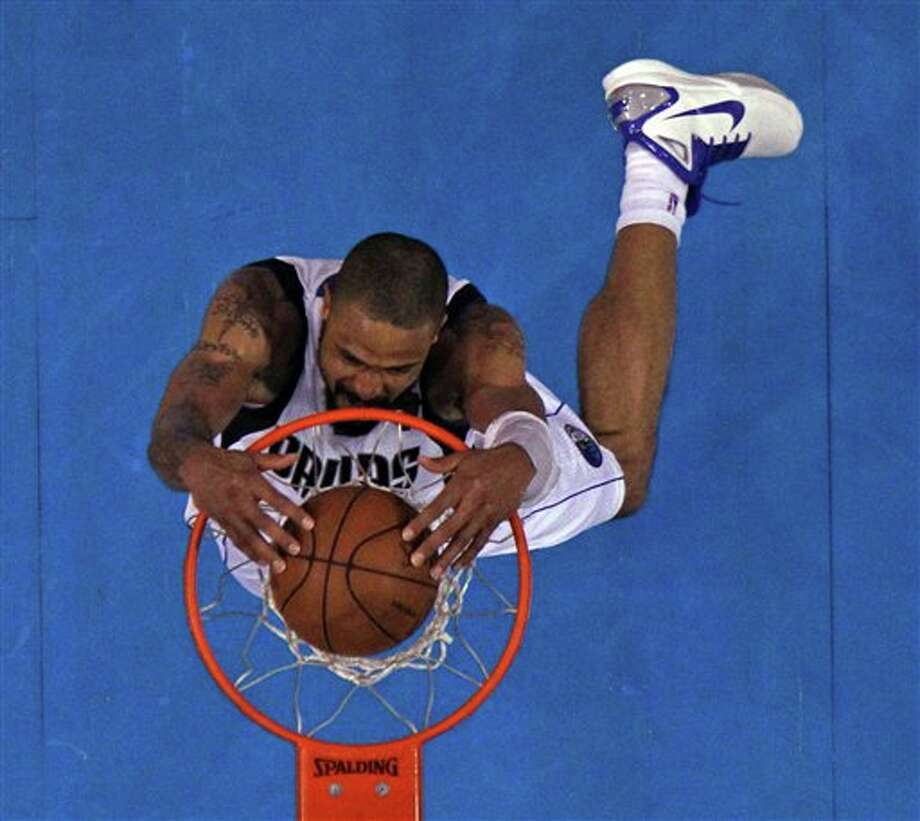 Dallas Mavericks' Tyson Chandler dunks during the second half of Game 5 of the NBA Finals basketball game against the Miami Heat Thursday, June 9, 2011, in Dallas. (AP Photo/Ronald Martinez; Pool) Photo: Ronald Martinez, Associated Press / Getty Images; Pool