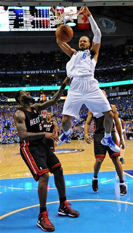 Dallas Mavericks' Tyson Chandler (6) dunks over Miami Heat's LeBron James (6) during the first half of Game 5 of the NBA Finals basketball game Thursday, June 9, 2011, in Dallas. (AP Photo/Larry W. Smith; Pool) Photo: Larry W. Smith, Associated Press / EPA Pool