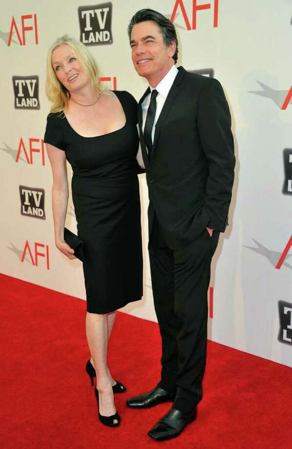 Actor Peter Gallagher (R) and Paula Harwood arrive. Photo: Alberto E. Rodriguez, Getty Images / 2011 Getty Images