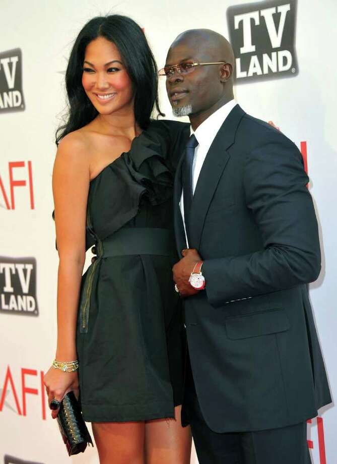 Designer Kimora Lee (L) and actor Djimon Hounsou arrive.  Photo: Alberto E. Rodriguez, Getty Images / 2011 Getty Images