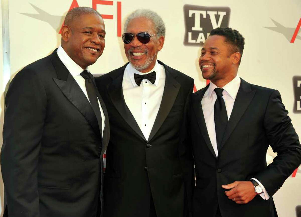 Director Forest Whitaker, 39th Life Achievement Award recipient Morgan Freeman and actor Cuba Gooding Jr. arrive.