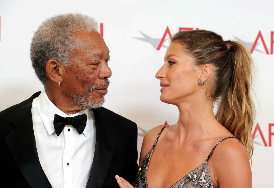 39th Life Achievement Award recipient Morgan Freeman (L) and model Gisele Bundchen pose. Photo: Frazer Harrison, Getty Images For AFI / 2011 Getty Images