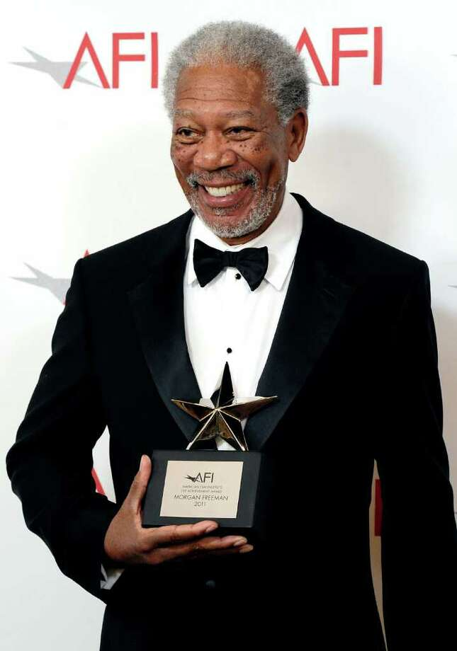 39th Life Achievement Award recipient Morgan Freeman poses with his award. Photo: Frazer Harrison, Getty Images For AFI / 2011 Getty Images