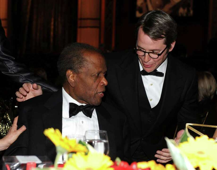 Actors Sidney Poitier  (L) and Matthew Broderick in the audience. Photo: Frazer Harrison, Getty Images For AFI / 2011 Getty Images