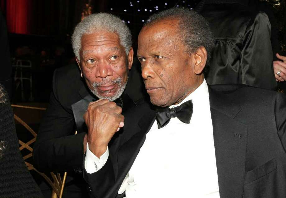 Morgan Freeman (L) and actor Sidney Poitier in the audience. Photo: Christopher Polk, Getty Images For AFI / 2011 Getty Images