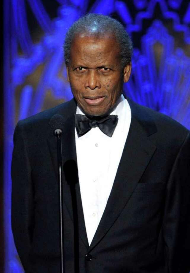Actor Sidney Poitier speaks onstage. Photo: Kevin Winter, Getty Images For AFI / 2011 Getty Images