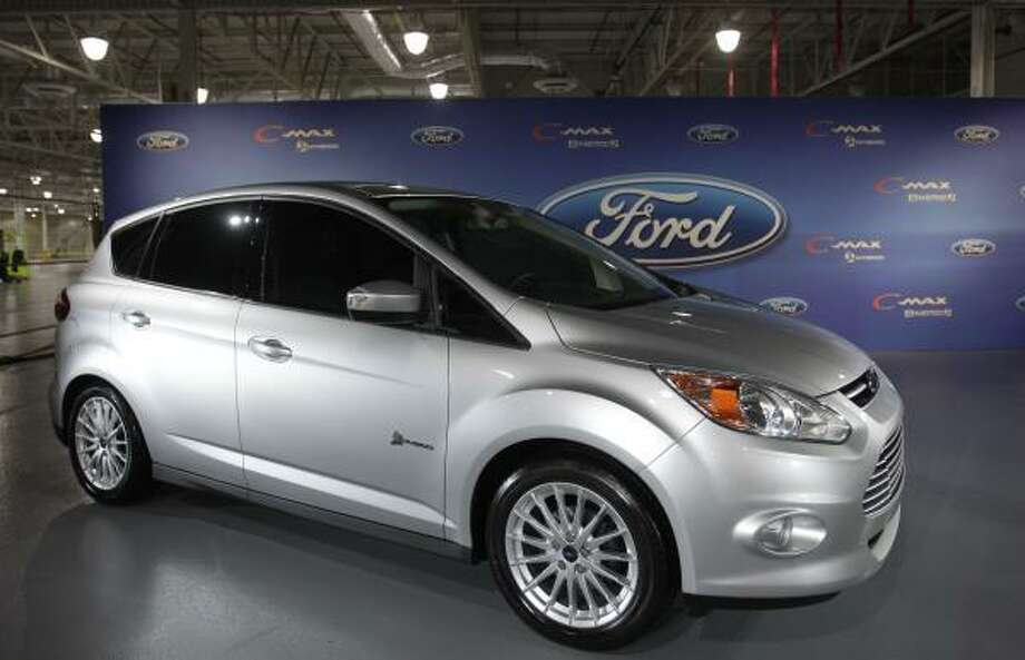 Ford offered a preview of the new C-Max hybrid Thursday at its Van Dyke Transmission Plant in Sterling Heights, Mich. The minivan will be Ford's first U.S. vehicle sold only as a hybrid. Photo: Carlos Osorio:, Associated Press