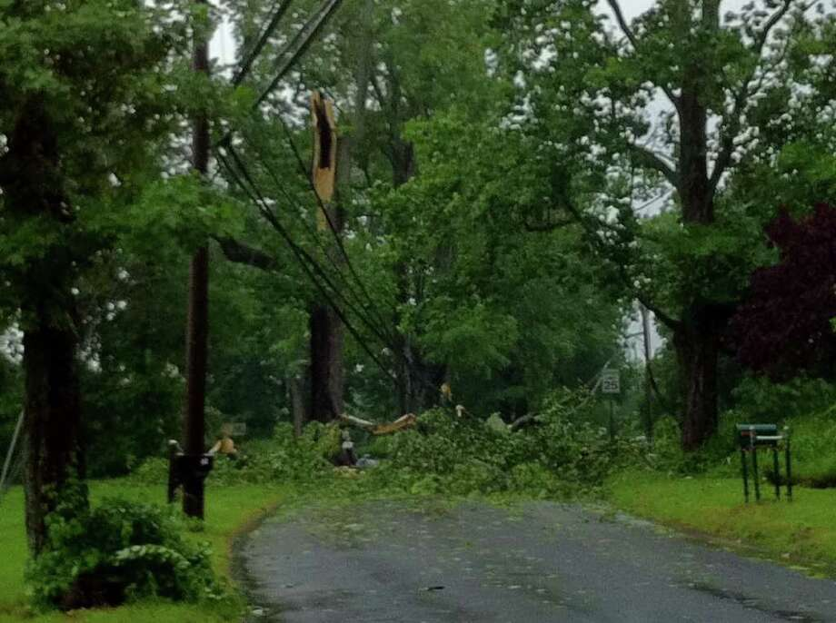 One of the many fallen trees in Greater Danbury is shown after the violent thunderstorms that swept through the area Thursday afternoon, June 9, 2011. This tree blocked traffic on Stadley Rough Road in Danbury. Photo: Carol Kaliff / The News-Times