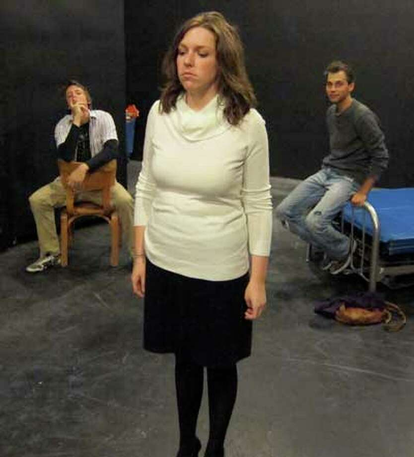 """Nathan Thurman (from left), Katie Krause and Ty Mylnar rehearse Proxy Theatre Company's """"Red Light Winter."""" Courtesy of Sarah Dropek"""