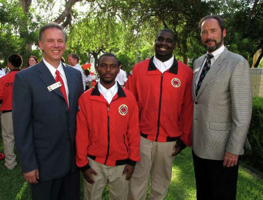 OTS/HEIDBRINK - Paul Garro (Exec Dir City Yr SA), Ron Arnold, Courtney Dailey (Alumni's) and Jeff Galt (Board Chair City Yr SA) were at the Americorps Graduation on 5/27/2011 at Our Lady of the Lake Univ. names checked photo by leland a. outz Photo: LELAND A. OUTZ, FREELANCER / SAN ANTONIO EXPRESS-NEWS