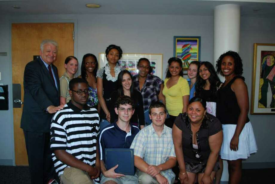 Norwalk Mayor Richard Moccia congratulates the Norwalk Mentor Scholarship Fund recipients at a ceremony June 7 at City Hall. Photo: Contributed Photo / Norwalk Citizen