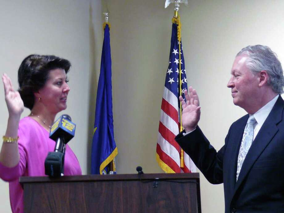 Town Clerk Betsy Browne administers the oath of office in formal ceremony Friday morning to interim First Selectman Michael Tetreau. Photo: Genevieve Reilly / Fairfield Citizen