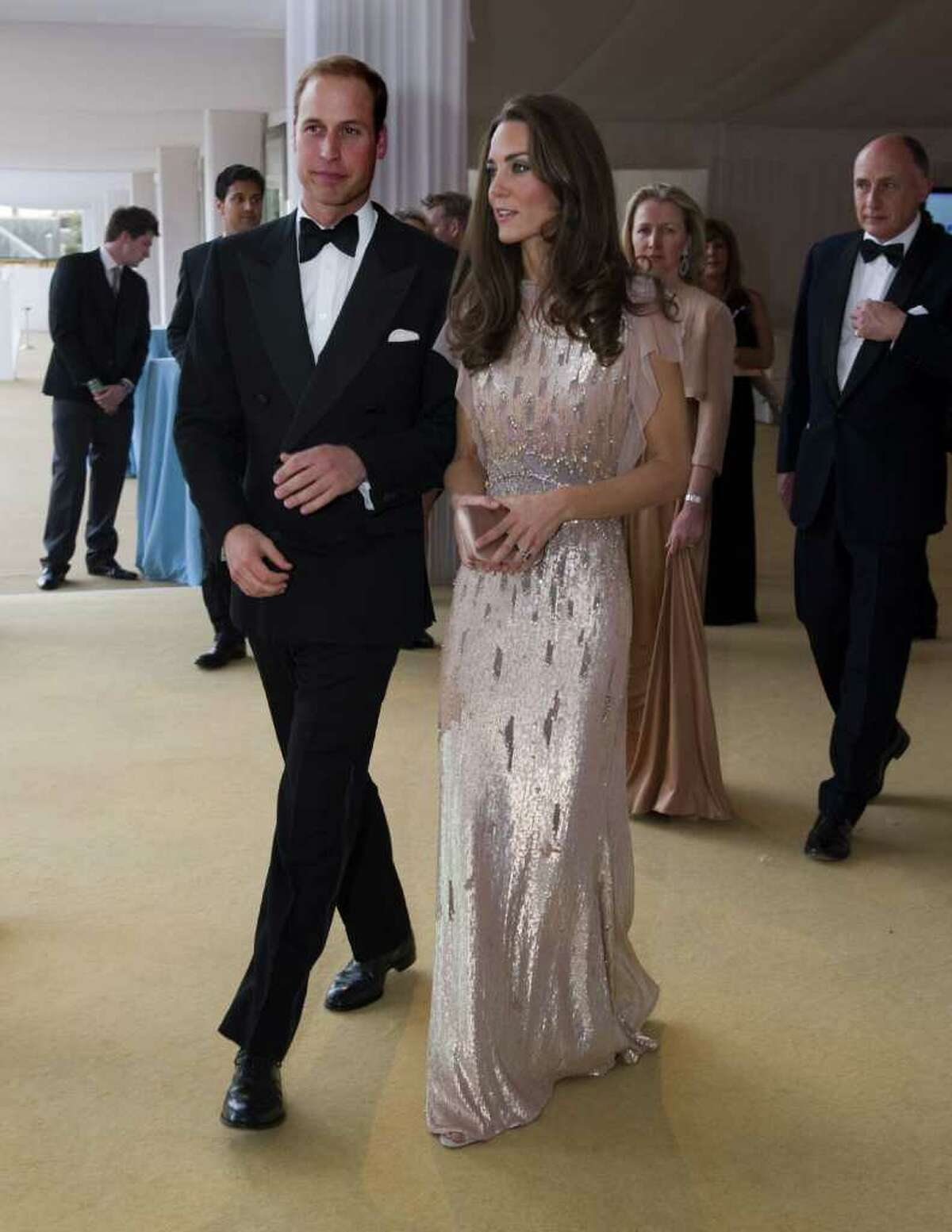 LONDON, ENGLAND - JUNE 09: Catherine, Duchess of Cambridge and Prince William, Duke of Cambridge arrive at the ARK 10th Anniversary Gala Dinner at Perk's Field on June 9, 2011 in London, England.