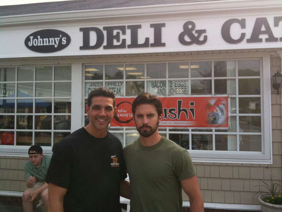 """Johnny Petrone, owner of The New Fairfield Food Center, stands with actor Milo Ventimiglia, who played Peter Petrelli on NBC's """"Heroes,"""" and was at the Food Center this week filming a scene for a new vampire flick. Photo: Contributed Photo/Erik Ofgang, Contributed Photo / The News-Times Contributed"""