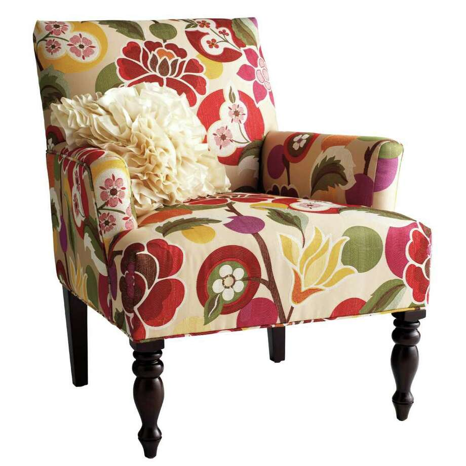 This product image courtesy of Pier 1 shows the Liliana floral chair. After a grim winter, it's fun to anticipate the first flower buds popping up. But home furnishings stores are already bursting with blossoms. Floral motifs are everywhere _ on furniture, textiles, wall art and accessories.    (AP Photo/Pier 1) NO SALES Photo: HO / Pier 1