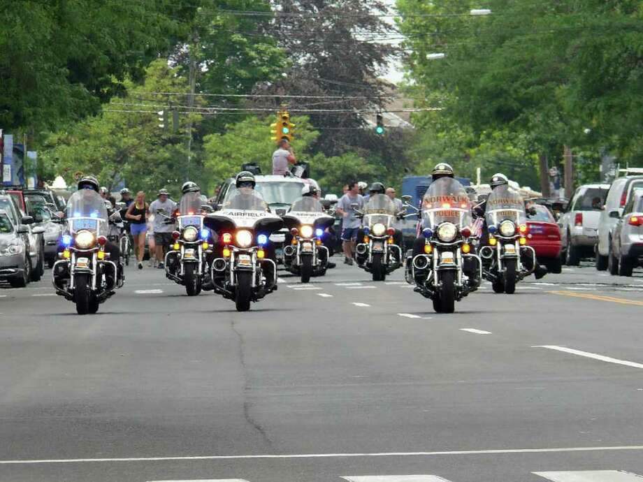 Motorcycle cops lead the way Friday when the Special Olympics Law Enforcement Torch Run came to town en route to Southern Connecticut State University for the Summer Games. Photo: Genevieve Reilly / Fairfield Citizen