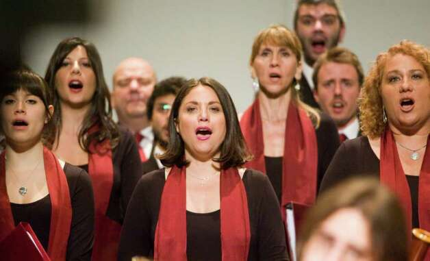 "The Choir of the Diocese of Rome, the PopeÕs Diocese, performs with the Livingston Symphony Orchestra at the Stamford Center for the ArtsÕ Palace Theatre in Stamford, Conn., on Thursday, June 9, 2011. The Choir is in residence at the Basilica of San Giovanni in Laterano and has performed at liturgies presided over by the Holy Father in many significant celebrations including at the Beatification Ceremony for Saint Mother Theresa of Calcutta and the singing in the Vatican during the final farewell to Pope John Paul II. The Choir is led by Monsignor Marco Frisina, the musical composer of ""The Divine Comedy,"" the first musical rendition of Dante AlighieriÕs masterpiece. Photo: Keelin Daly / Stamford Advocate"