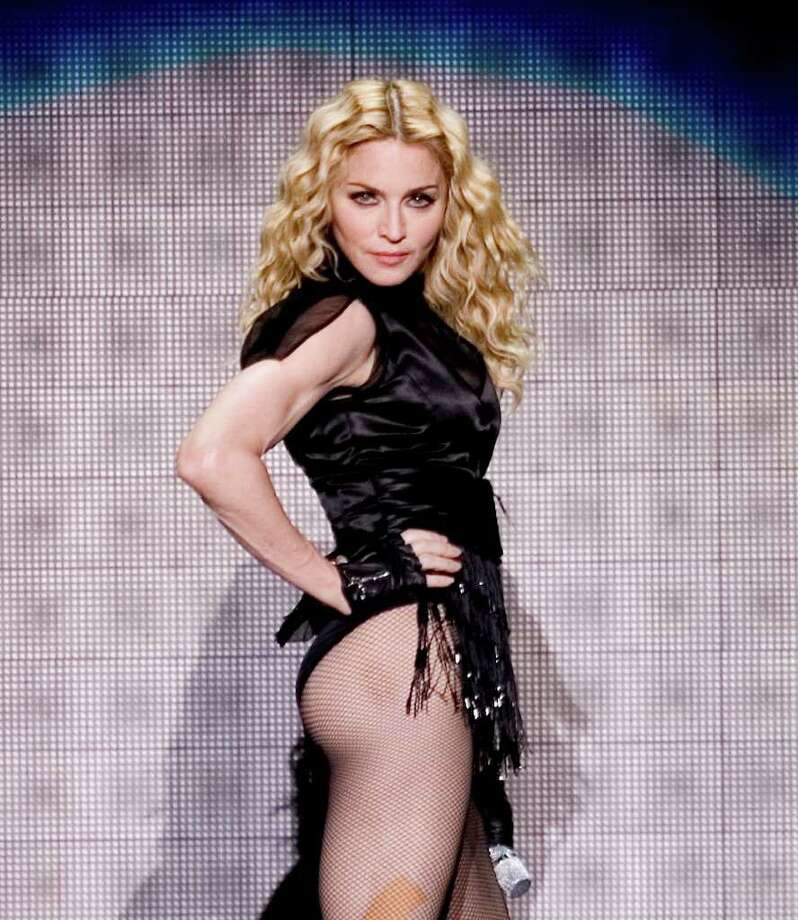"** FILE ** In this Nov. 29, 2008 file photo, Madonna performs during her ""Sticky and Sweet""  tour at  Foro Sol in Mexico City.  (AP Photo/Eduardo Verdugo, file) Photo: Eduardo Verdugo, STF / AP"