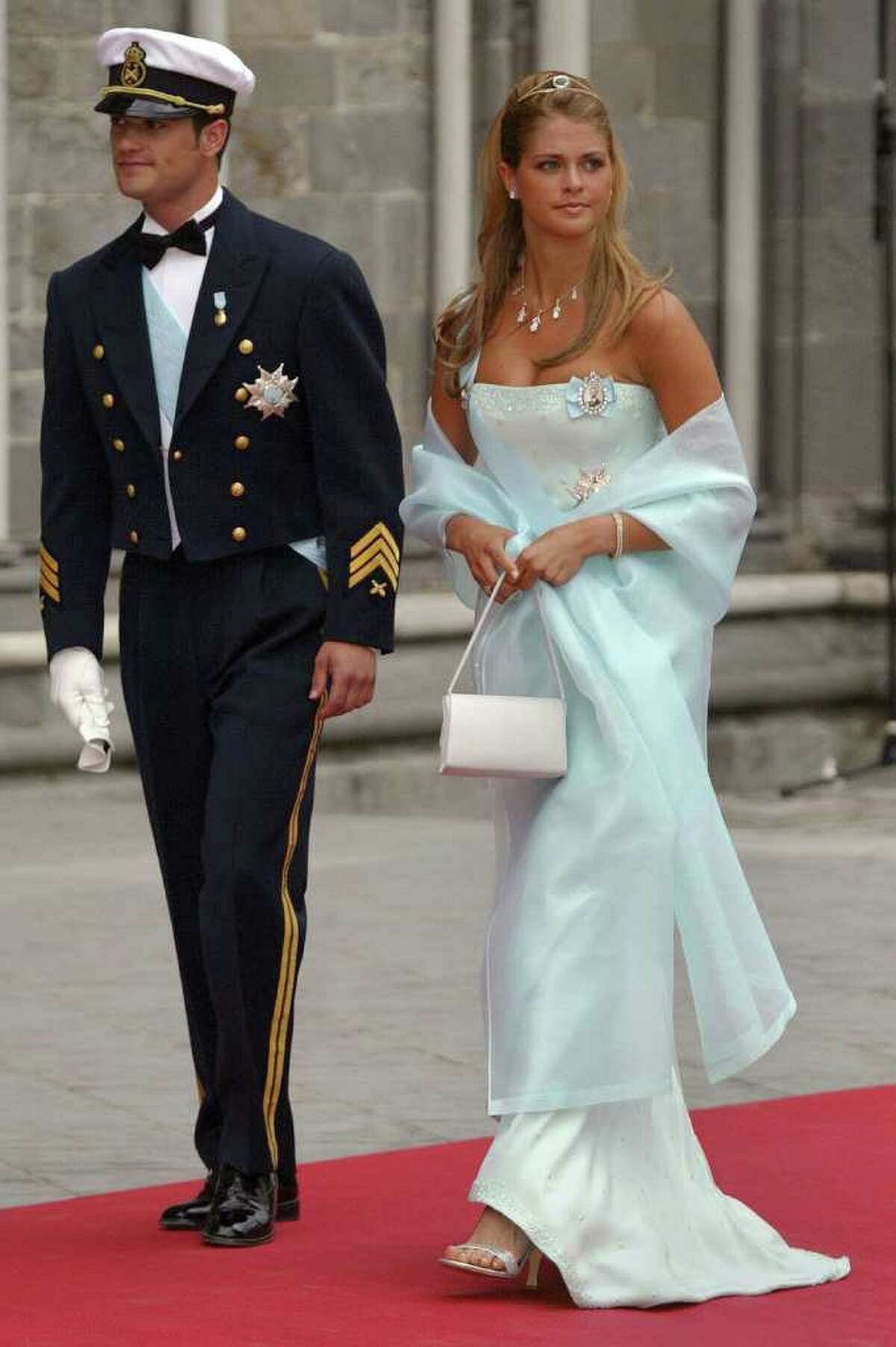 Princess Madeleine and her brother, Prince Carl Phillip, arrive at the wedding ceremony of Princess Martha Louise of Norway and writer Ari Behn at the Nidaros Cathedral May 24, 2002 in Trondheim, Norway.