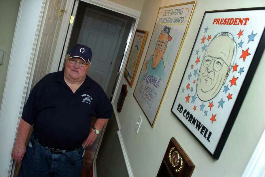 Ed Cornwell, who has been involved with the Senior City League baseball in Bridgeport for 60 years, poses with some of his memorabilia at his home in Bridgeport, Conn. on Friday June 10, 2011. Photo: Christian Abraham / Connecticut Post