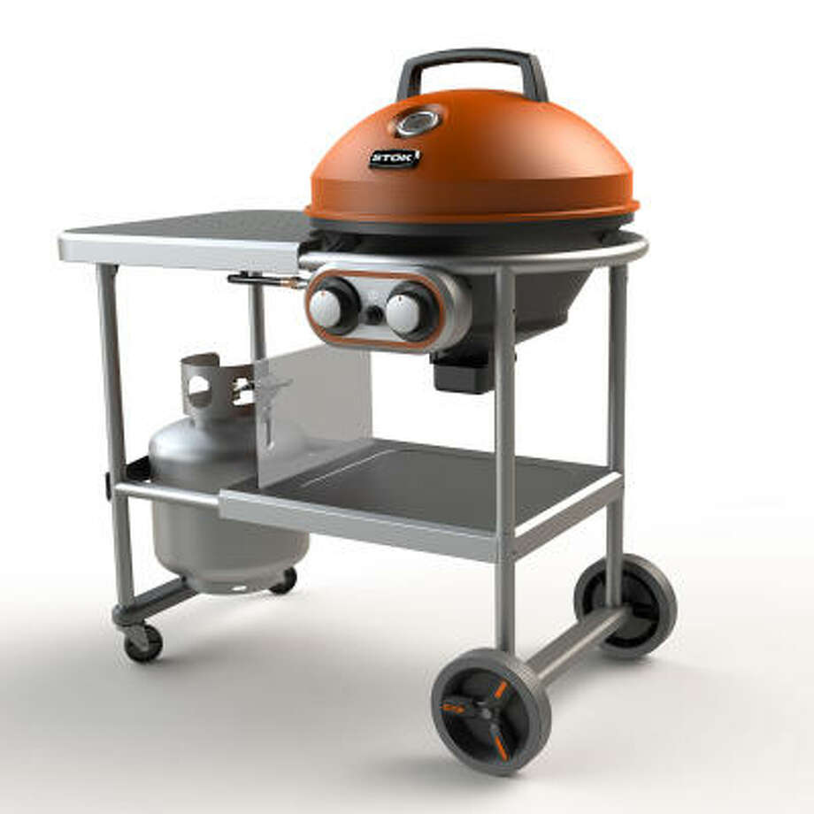 STOK's 25,000 BTU Island grill comes with a pizza stone, a vegatable tray and cast-iron grates. Photo: HOME DEPOT