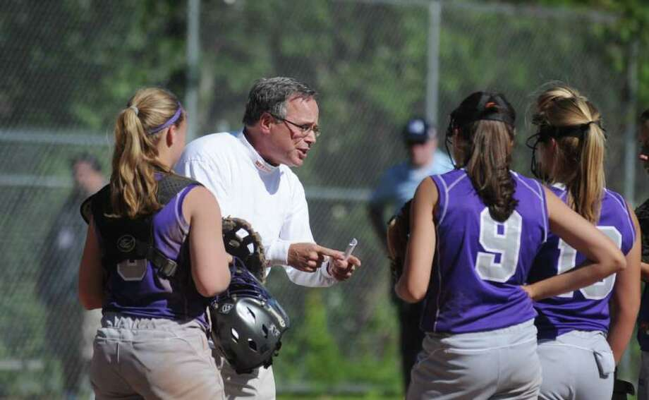 Westhill High School head coach Tom Pia rallies his team against Amity High School in the CIAC softball quarterfinals in Stamford, Conn. on Friday June 3, 2011. Photo: Kathleen O'Rourke, ST / Stamford Advocate