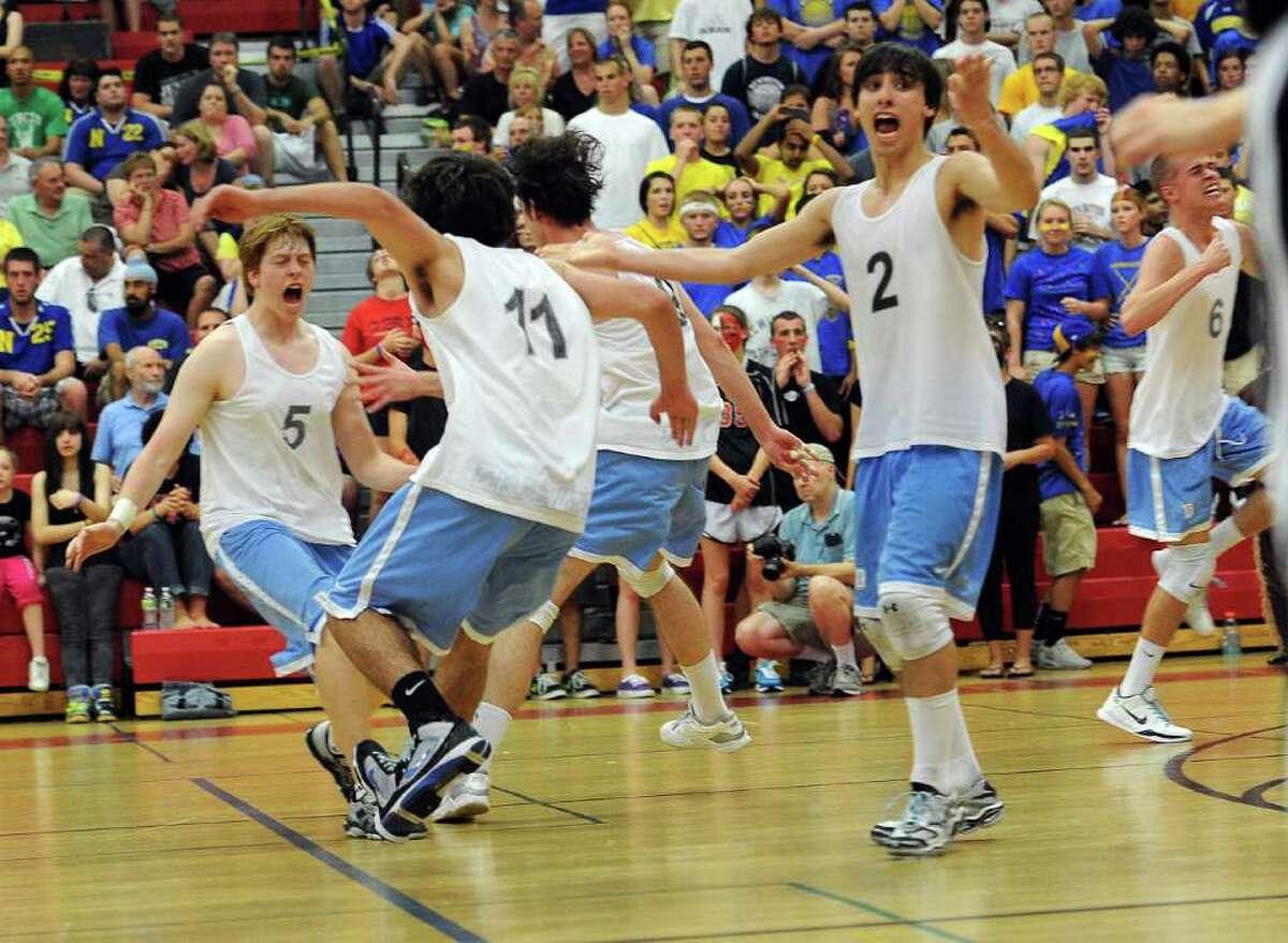 Darien celebrates winning Friday's class M championship game at Fairfield Warde High School on June 10, 2011.