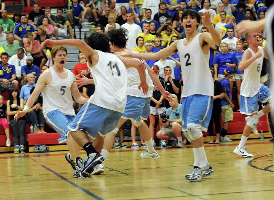 Darien celebrates winning Friday's class M championship game at Fairfield Warde High School on June 10, 2011. Photo: Lindsay Niegelberg / Connecticut Post