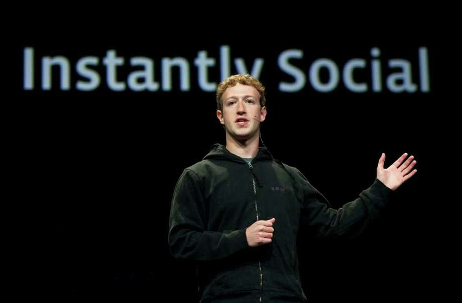 Mark Zuckerberg, founder and chief executive officer of Facebook Inc., appears at a developer conference in San Francisco, California, in this file photo. A survey of 100 organizations in Fairfield County and metropolitan New York by OperationsInc and Performance-Solutions-Group Inc., both Stamford-based consulting firms, found that 33 percent of employers have experienced improper use of Facebook by an employee. Photographer: Kim White/Bloomberg Photo: Kim White, ST