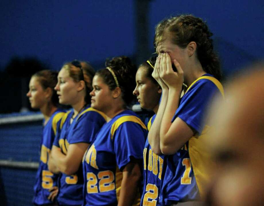 Seymour's #1 Kelly Ferris covers her face in dejection as the team is beat by Sacred Heart Academy, during Class M State Championship softball action in West Haven, Conn. on Friday June 10, 2011. Photo: Christian Abraham