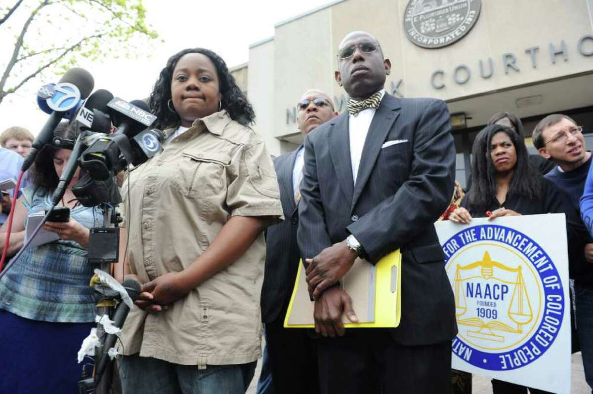 Tanya McDowell, left, conducts a news conference before her arraignment at Norwalk Superior Court on larceny charges in Norwalk, Conn. on Wednesday April 27, 2011. She is accompanied by her attorney Darnell Crosland. McDowell allegedly used a false Norwalk address to enroll her son in Brookside Elementary School. Norwalk police arrested McDowell Friday on drug charges.