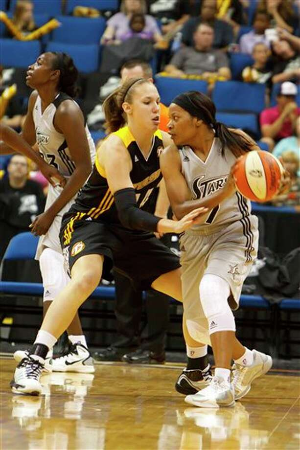 The Silver Stars' Jia Perkins (right) faces the defense of the Shock's Kayla Pederson on Friday in Tulsa, Okla. AP Photo/Tulsa World, Kevin Pyle Photo: Associated Press