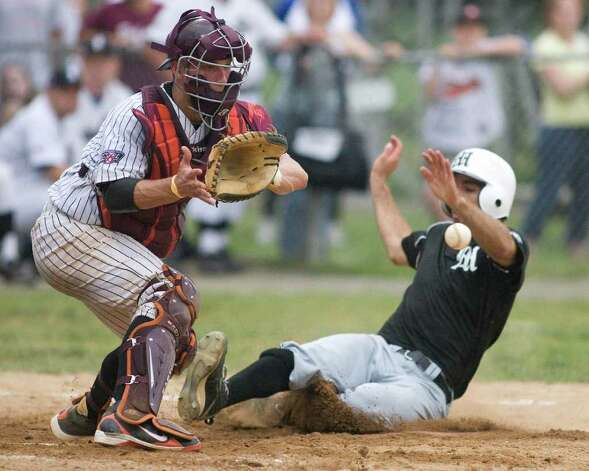 Westerners' catcher Chad Morgan waits for the late throw from second baseman Chris Waylock as Mystic's Steve Maier scores Friday night at Rogers Park. Photo: Barry Horn / The News-Times Freelance