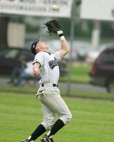 Westerners' second baseman Chris Waylock makes an over the shoulder catch of a ball into short right field Friday night at Rogers Park. Photo: Barry Horn / The News-Times Freelance