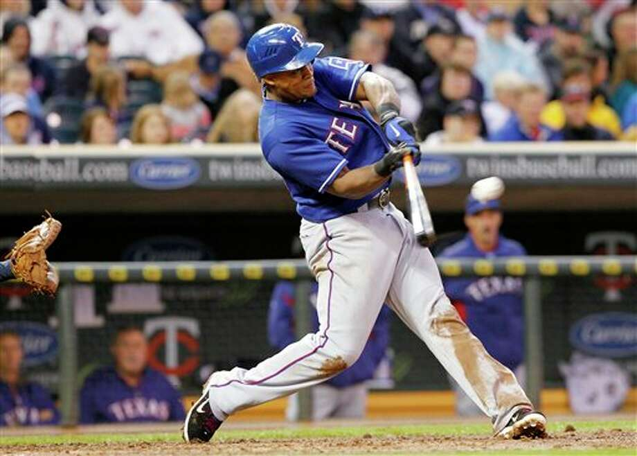 Texas Rangers' Adrian Beltre hits an RBI-single against the Minnesota Twins during the fourth inning of a baseball game on Friday, June 10, 2011, in Minneapolis. (AP Photo/Genevieve Ross) Photo: Associated Press