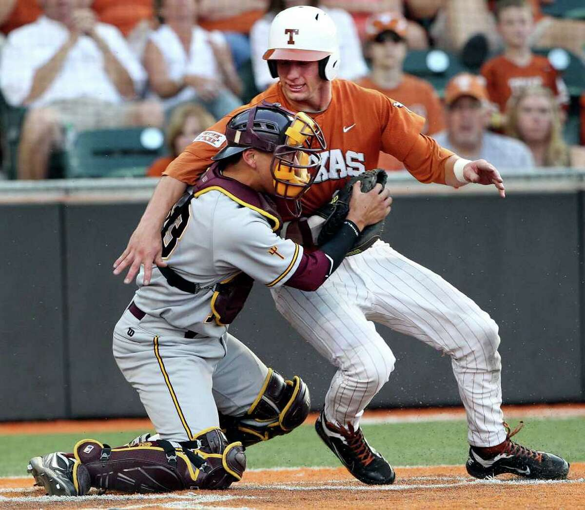 SPORTS Longhorn runner Jacob Felts is blocked from the plate by catcher Austin Barnes after being forced to try to take home in the seventh as The University of Texas Longhorns play Arizona State at Disch-Falk Field in Austin on June 10, 2011. Tom Reel/Staff