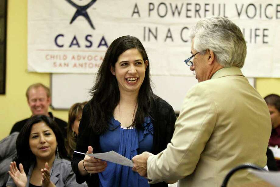 Melissa Anderson receives her certificate from Judge Richard Garcia after being sworn in as a Child Advocates San Antonio volunteer.  ANDREW BUCKLEY / abuckley@express-news.net Photo: ANDREW BUCKLEY, Andrew Buckley/Express-News / SAN ANTONIO EXPRESS-NEWS