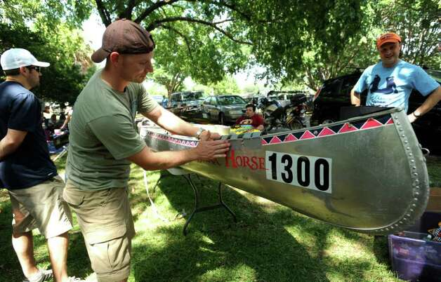 "Joe Mann prepares the ""Dark Horse"" canoe a day before the Texas Water Safari, a 260-mile race on the San Marcos and Guadalupe rivers from San Marcos to the Gulf Coast. Photo: Billy Calzada/Express-News / gcalzada@express-news.net"