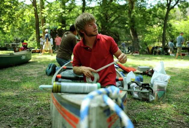 Shea Rapp prepares his canoe for the Texas Water Safari at Aquarena Springs on Friday, June 10, 2011. The race kicks off at 9 a.m. on Saturday. Photo: Billy Calzada/Express-News / gcalzada@express-news.net