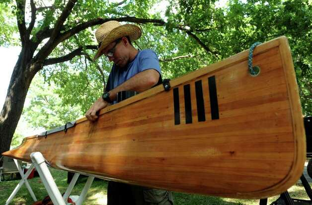 Curtis Slaten will be canoeing 260 miles of the Texas Water Safari in a wooden watercraft that he built. Photo: Billy Calzada/Express-News / gcalzada@express-news.net