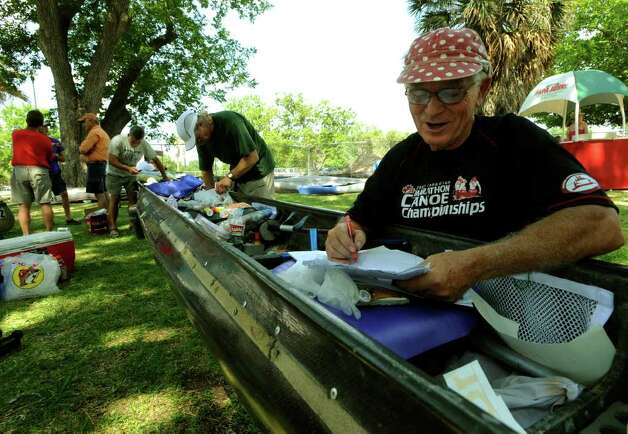 Bob Vincent, 68, prepares belongings in his team's canoe for the Texas Water Safari, a 260-mile race on rivers from San Marcos to the Gulf Coast. Each member of Vincent's team is over 60 years old. Photo: Billy Calzada/Express-News / gcalzada@express-news.net