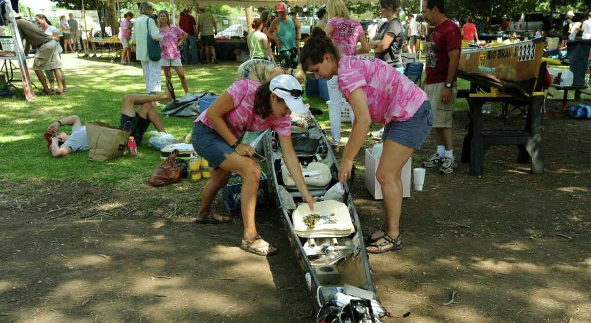 A six-woman team of competitors in the Texas Water Safari prepare their craft on Friday, June 10, 2011.