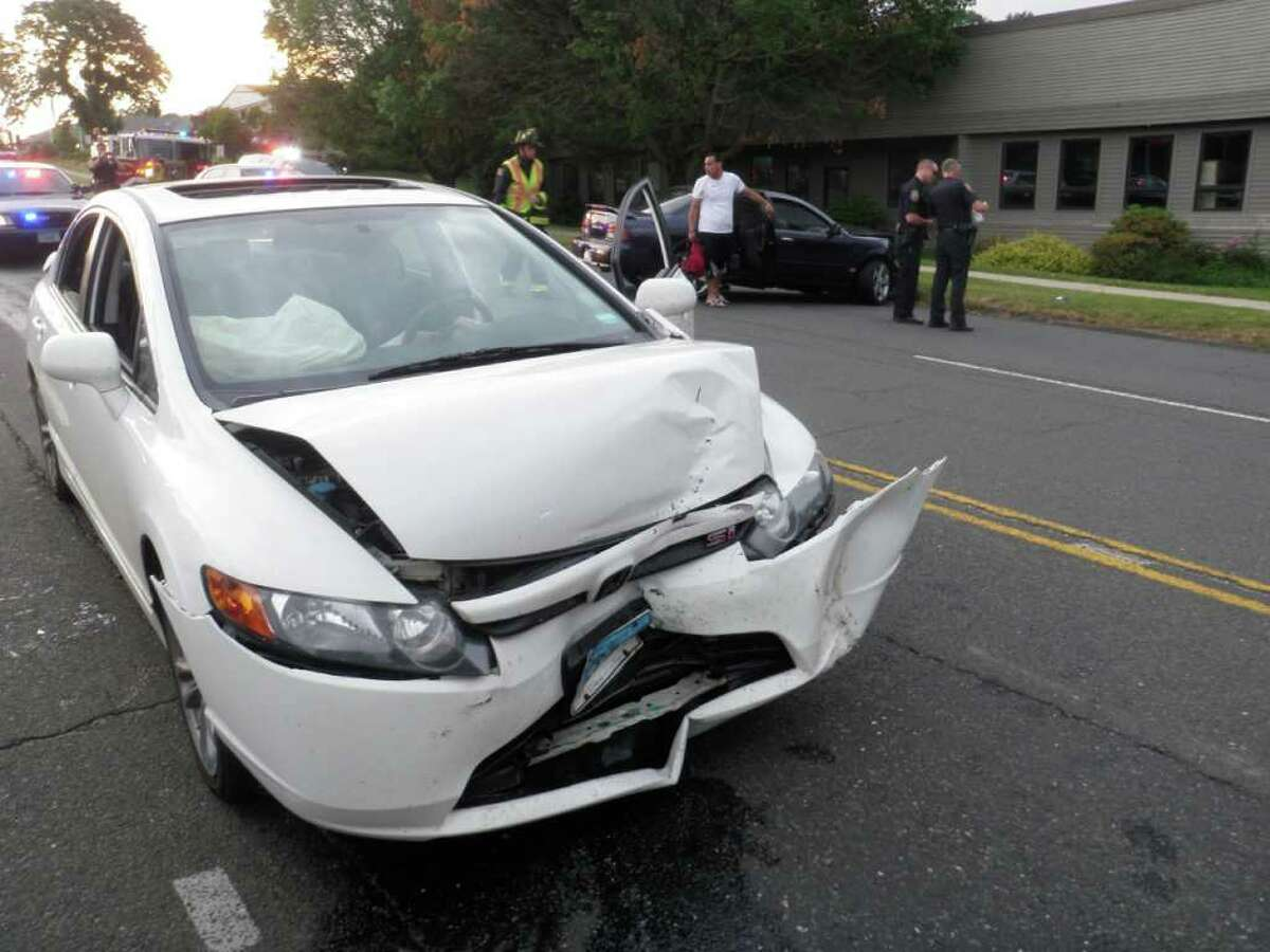 Occupants of this car were uninjured after colliding with another car Friday night on Post Road East.