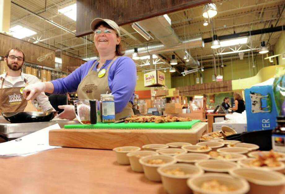 Cooking coach Michelle Ryan, of Milford, whips up homemade granola in the bulk foods section at the new Whole Foods market in Fairfield, Conn. Wednesday, June 1, 2011.  The new store opens Friday, June 3, 2011. Photo: Autumn Driscoll / Connecticut Post