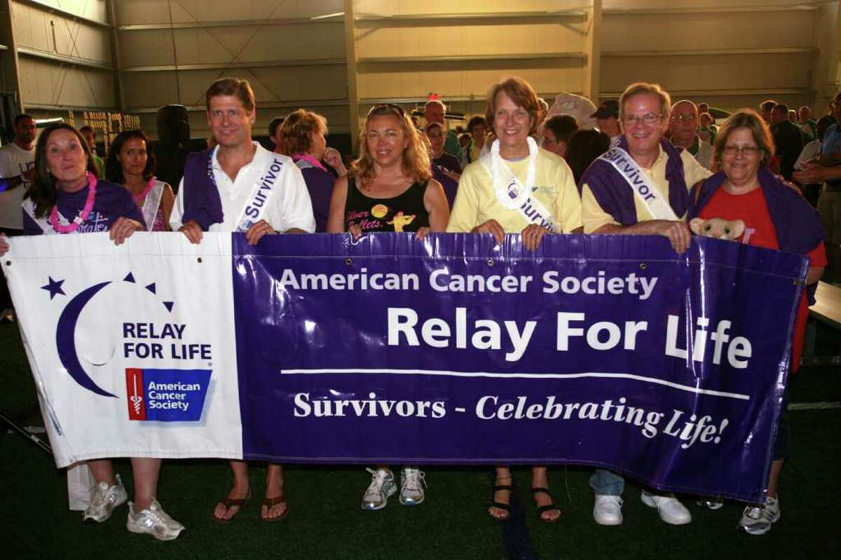 Cancer survivors lead the way during the Relay For Life at the Sono Field House in South Norwalk and sponsored by the American Cancer Society Friday night, June 10, 2011.