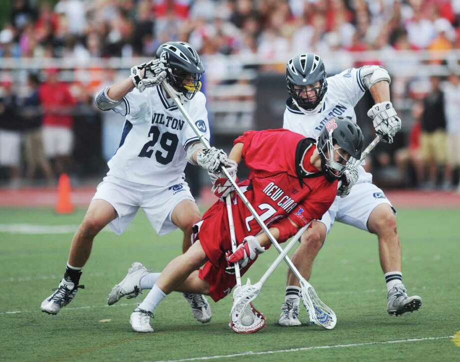 Wilton High School's Graham Parson and Patrick Holland double team New Canaan High School's Matt Biasco in the Class M boys lacrosse championship game at Brien McMahon High School in Norwalk, Conn. on Saturday June 11, 2011. Wilton won 12-2. Photo: Kathleen O'Rourke / Stamford Advocate