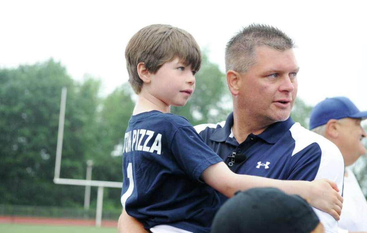 Wilton High School head coach John Wiseman celebrates with his son Sean after defeating New Canaan High School 12-2 in Class M boys lacrosse championship game at Brien McMahon High School in Norwalk, Conn. on Saturday June 11, 2011.